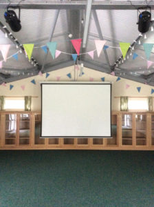 The hall with projection screen ready to use